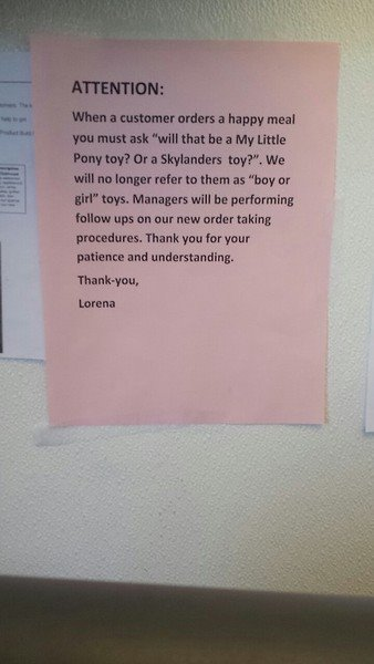 An employee sign asking cashiers to emphasize toy name over toy